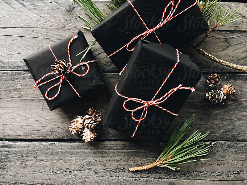 Presents and pinecones by Helen Rushbrook for Stocksy United