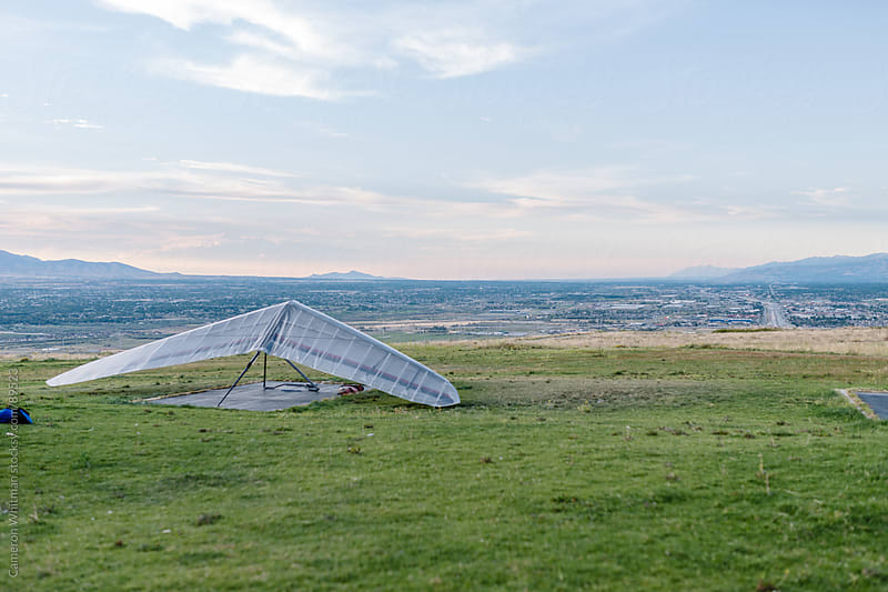 Hanglider at launching site over the Salt Lake valley.  by Cameron Whitman for Stocksy United