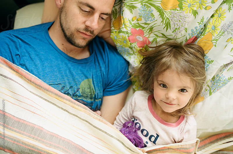 little girl and dad in morning by Maria Manco for Stocksy United
