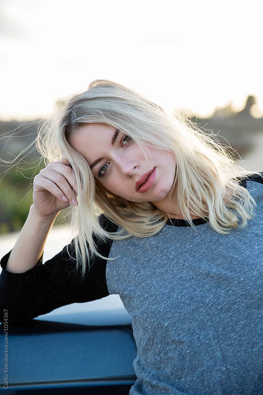 Pretty blonde woman leaning on her truck by Curtis Kim for Stocksy United