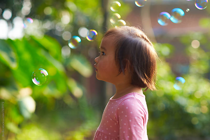 lovely little asian girl playing with bubble outdoor by cuiyan Liu for Stocksy United