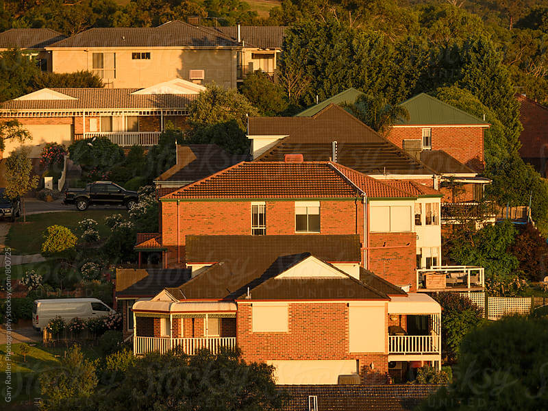 Houses on a Hill in a Melbourne Outer Suburb by Gary Radler Photography for Stocksy United