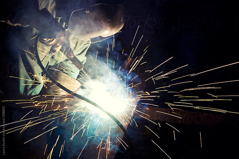 Metal Worker Soldering Metal With Sparks by Laura Austin for Stocksy United