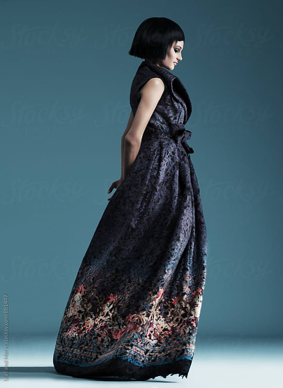 model wearing haute couture dresses on blue background by Ulaş and Merve for Stocksy United