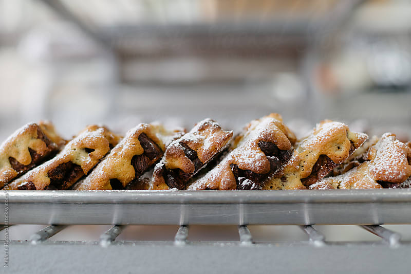 Pastries on a bakers rack by Melanie Riccardi for Stocksy United
