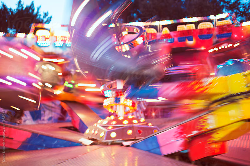 fun park motion blur background by Sonja Lekovic for Stocksy United