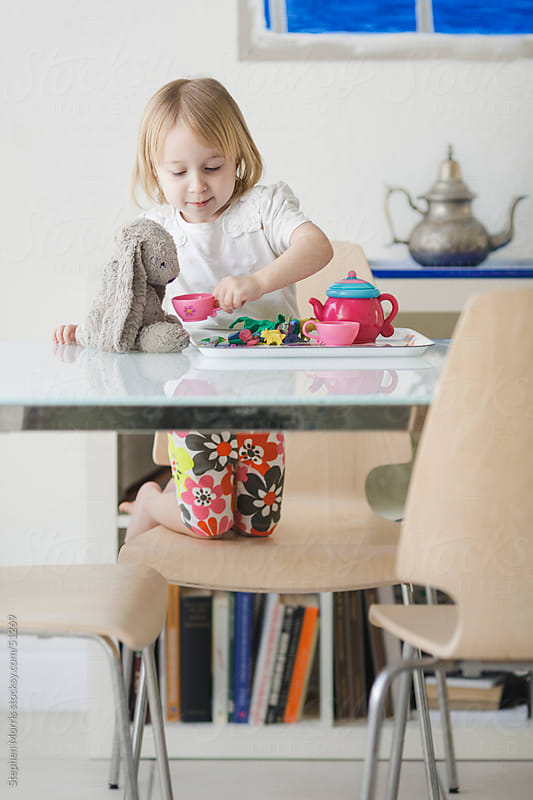 Little Girl Playing Tea Party by Stephen Morris for Stocksy United