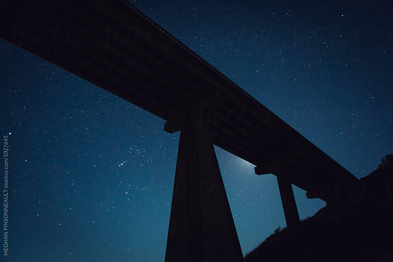 Bridge Silhouette with Glowing Moon and Stars by MEGHAN PINSONNEAULT for Stocksy United