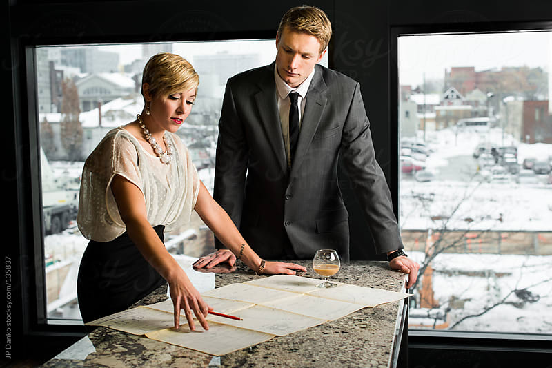 Business Man and Business Woman at Luxury Office at Work by JP Danko for Stocksy United