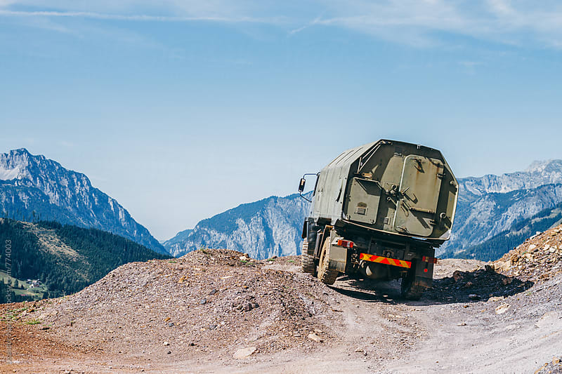 offroad truck in rugged alpine landscape by Leander Nardin for Stocksy United