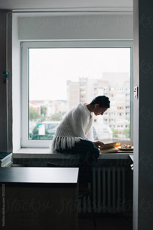 Woman having a breakfast in the kiitchen by Marija Mandic for Stocksy United