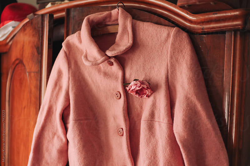 Pink flower on a pink jacket - horizontal by Marija Kovac for Stocksy United
