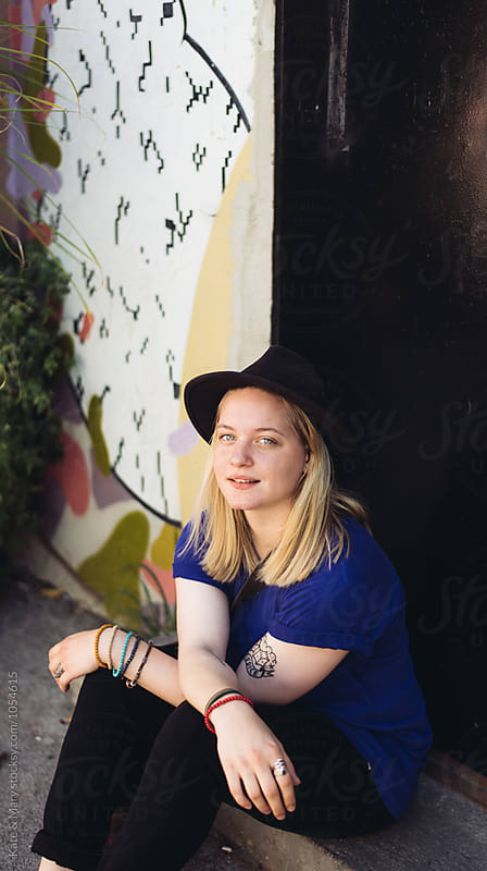 Portrait of urban woman with hat by Katarina Simovic for Stocksy United