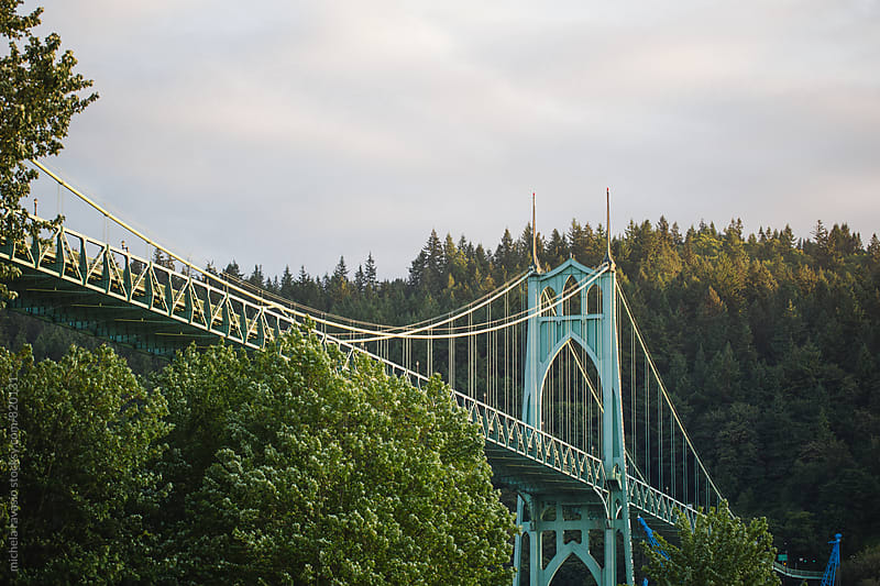 St. Johns Bridge between trees, Portland, Oregon by michela ravasio for Stocksy United