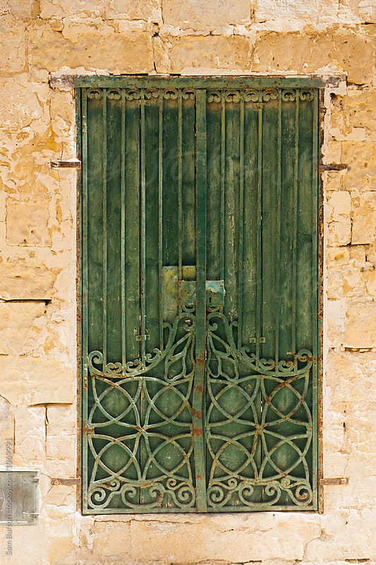 Rustic metal door by Sam Burton for Stocksy United