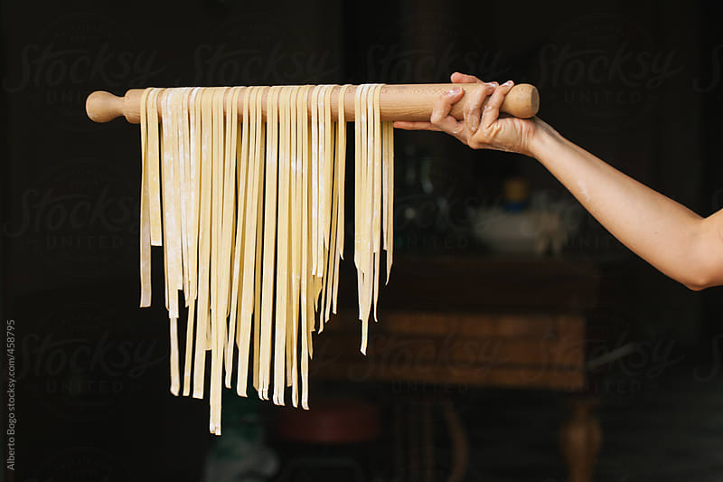 Woman holding fresh pasta by Alberto Bogo for Stocksy United