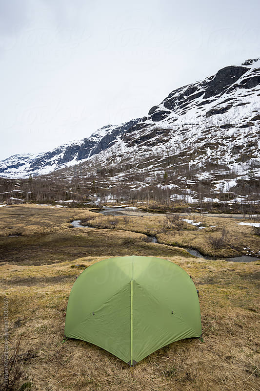 Green backpacker tent in the mountains. by Tristan Kwant for Stocksy United