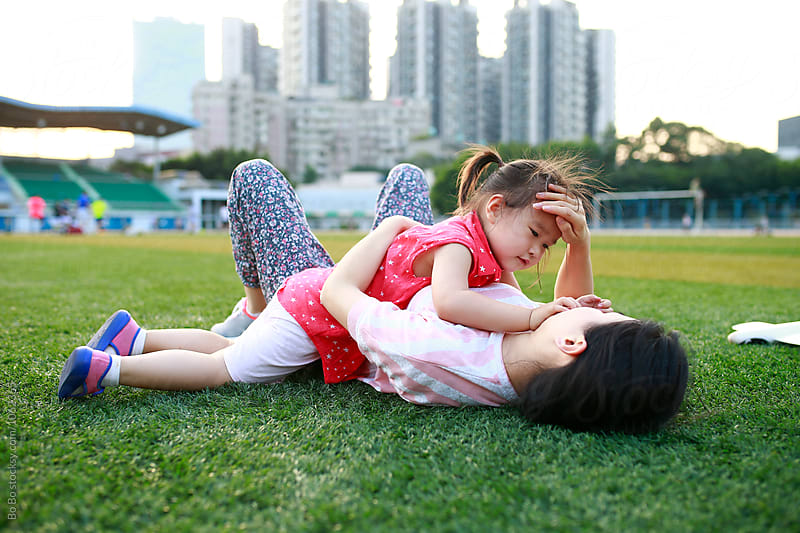 little girl having fun with her mother outdoor by Bo Bo for Stocksy United