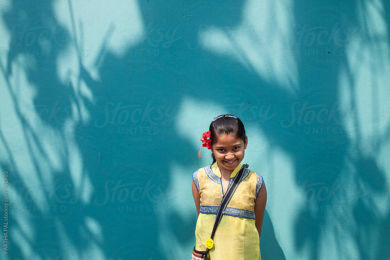 A happy girl laughing and looking at camera by PARTHA PAL for Stocksy United