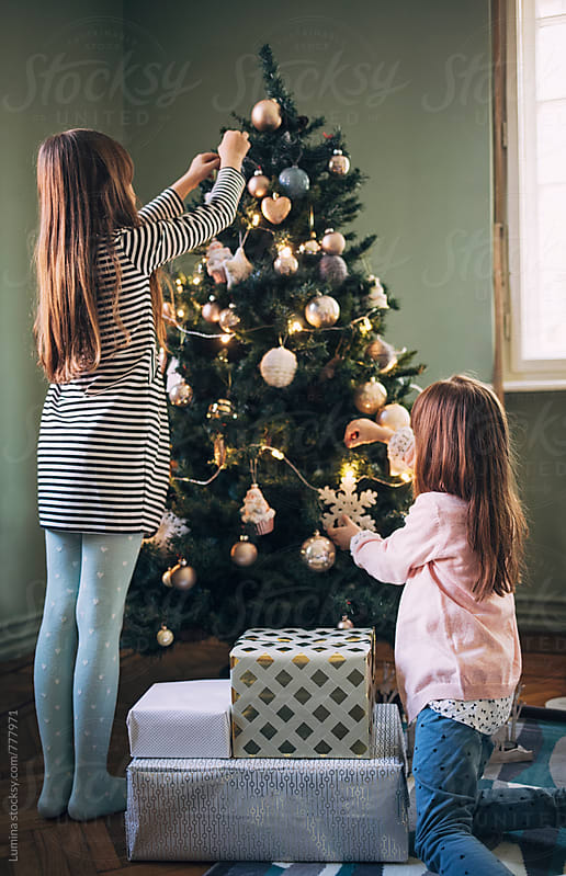 Girls Decorating the Christmas Tree by Lumina for Stocksy United