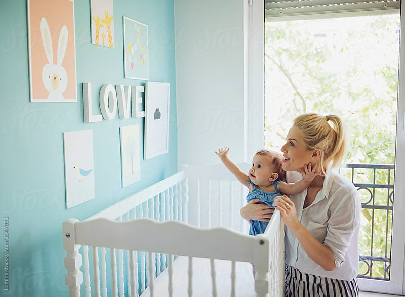 Woman Playing Witha Baby Girl in Her Crib by Lumina for Stocksy United