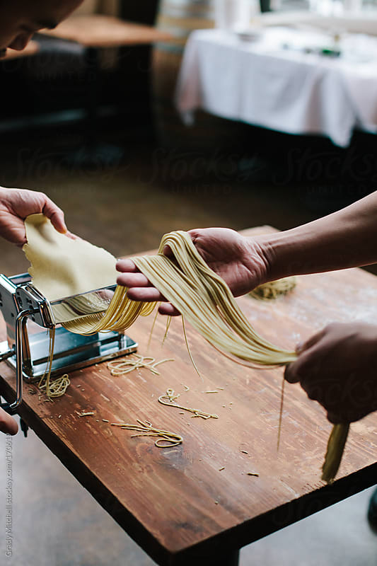 Pasta Noodles Going Through Roller by Grady Mitchell for Stocksy United