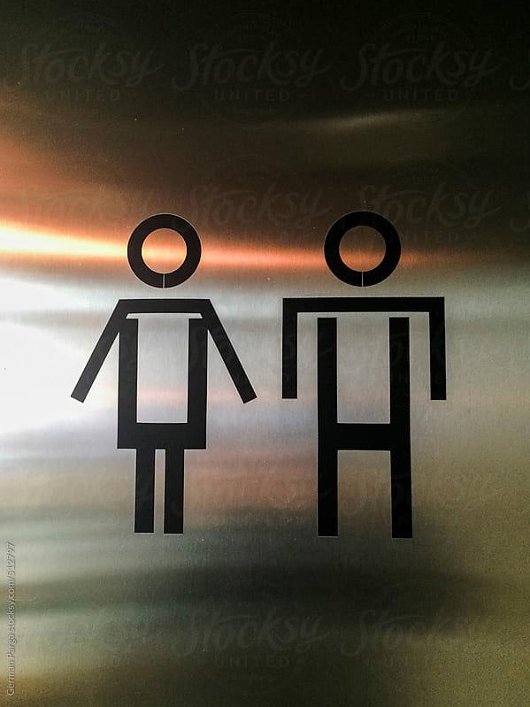 Unisex bathroom sign  by German Parga for Stocksy United
