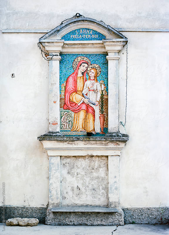 Ancient holy aedicule in italian narrow street  by Laura Stolfi for Stocksy United