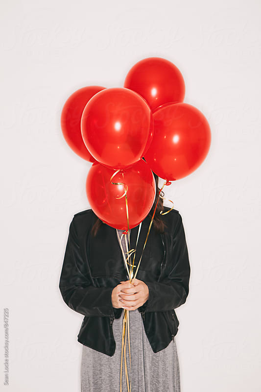 Valentine: Woman Holds Bunch Of Red Balloons by Sean Locke for Stocksy United