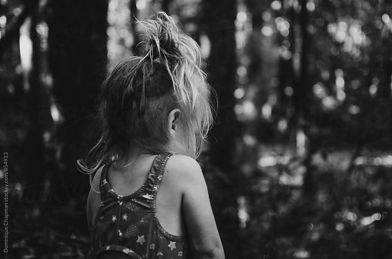 Black and white image of little girl by Dominique Chapman for Stocksy United