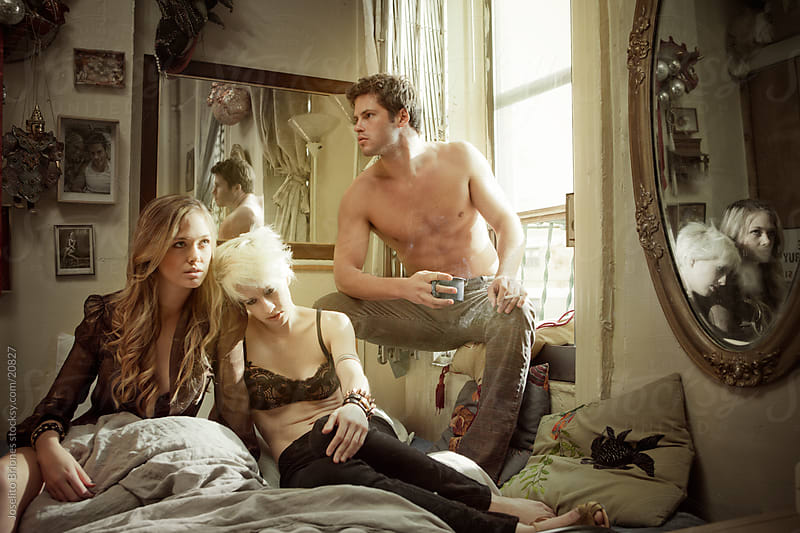Menage-a-trois in a Bedroom by Joselito Briones for Stocksy United