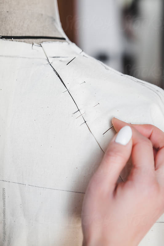 Fashion Designer Putting Pins on a Mannequin by Giorgio Magini for Stocksy United