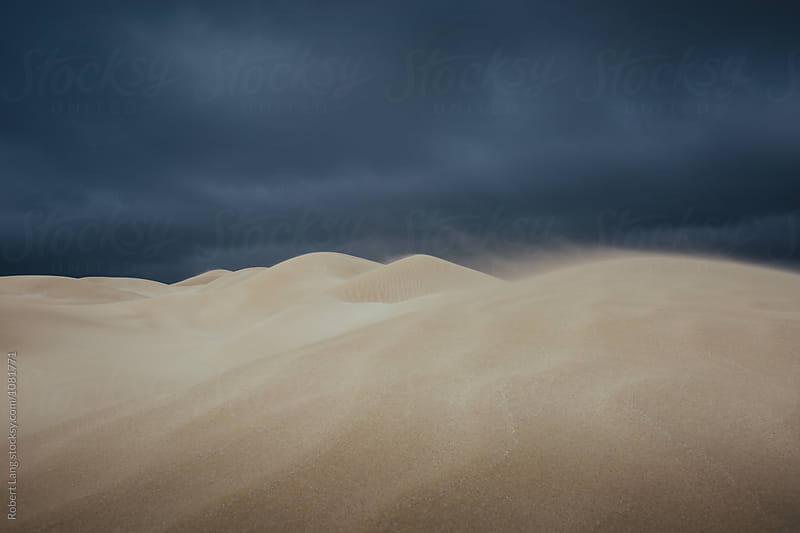 Storm clouds over sand dunes, Australia by Robert Lang for Stocksy United