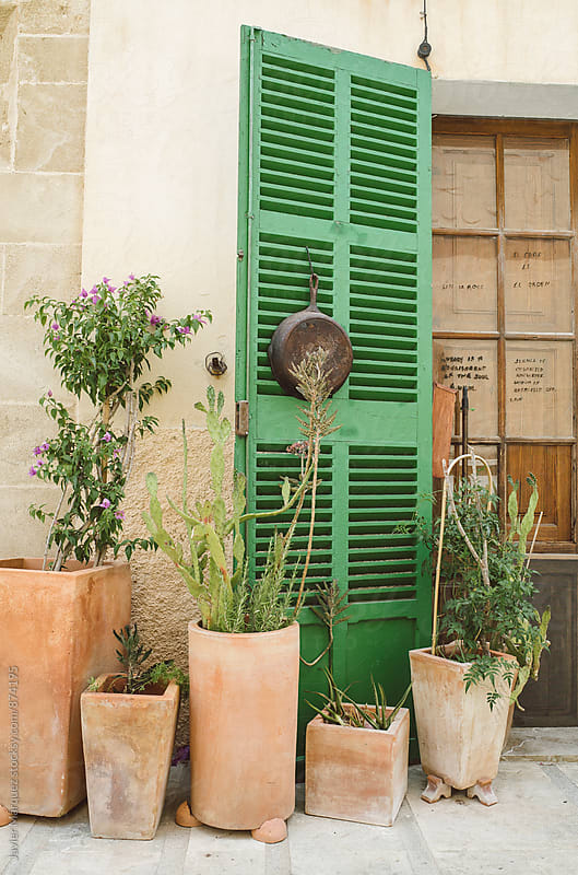 Door and pots in a house by Javier Márquez for Stocksy United