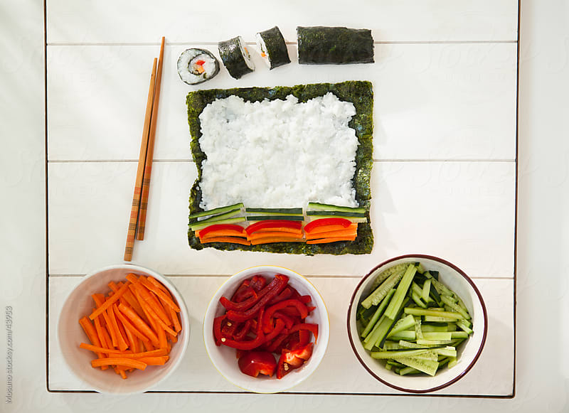 Preparing sushi. by Mosuno for Stocksy United