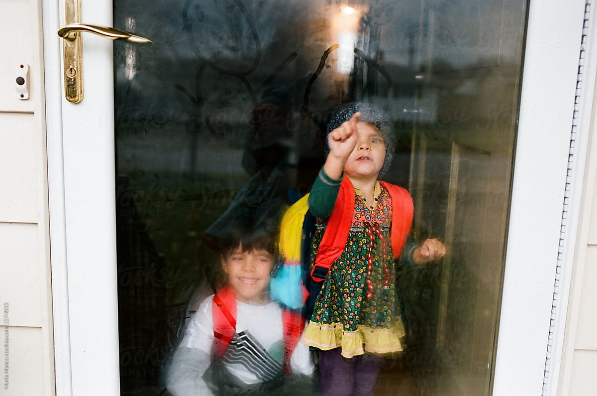 Little Girl Frawing On Frosted Door Stocksy United