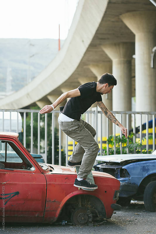 Young man performing a skate trick by Ani Dimi for Stocksy United