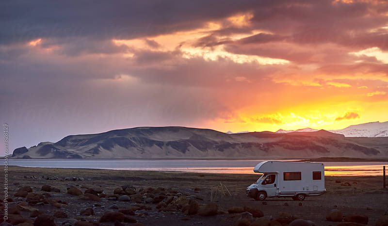 Campervan parked at sunset by Daxiao Productions for Stocksy United