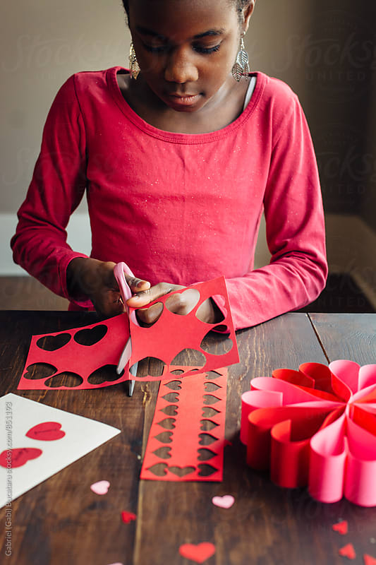 Black girl doing valentines by Gabriel (Gabi) Bucataru for Stocksy United