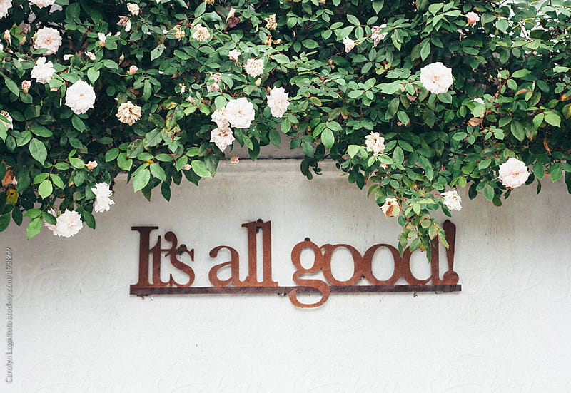 Sign on a wall saying: It's all good! by Carolyn Lagattuta for Stocksy United