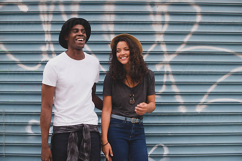 Young happy couple hanging out in the city by Lauren Naefe for Stocksy United