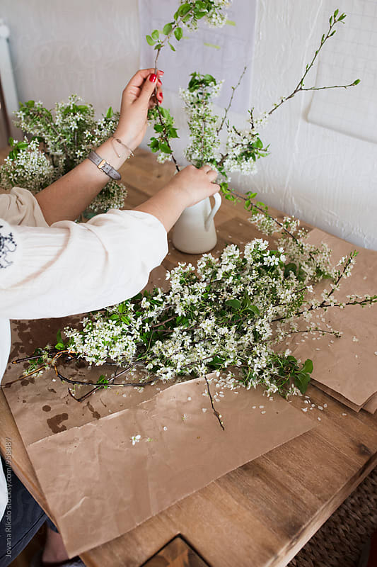 Young woman making flower bouquet by Jovana Rikalo for Stocksy United