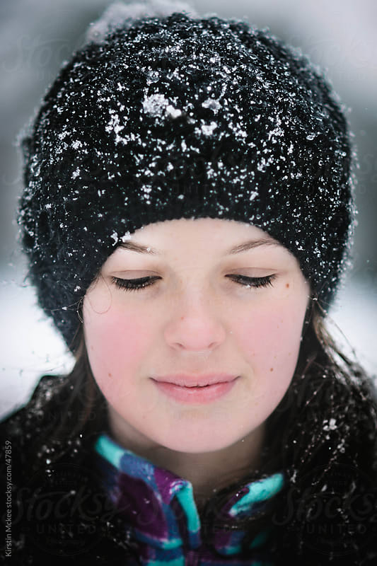 Caucasian girl with snow on her eyelashes. by Kirstin Mckee for Stocksy United