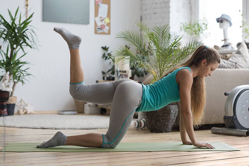 Woman doing exercises at home by Milles Studio for Stocksy United