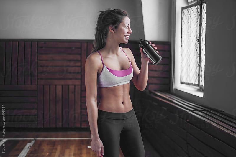 Woman taking a break of workout. by Studio Firma for Stocksy United