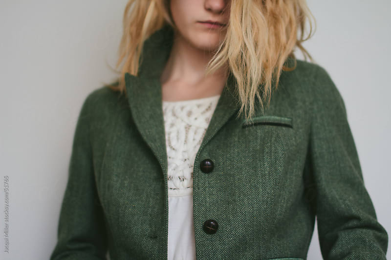 Girl with Blonde hair Modelling a Green Jacket and Summer Dress by Jacqui Miller for Stocksy United