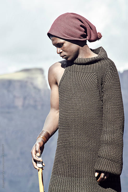 Portrait of a young male black Basotho shepherd. by Jacques van Zyl for Stocksy United