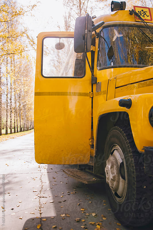 Yellow school bus in the street by Danil Nevsky for Stocksy United
