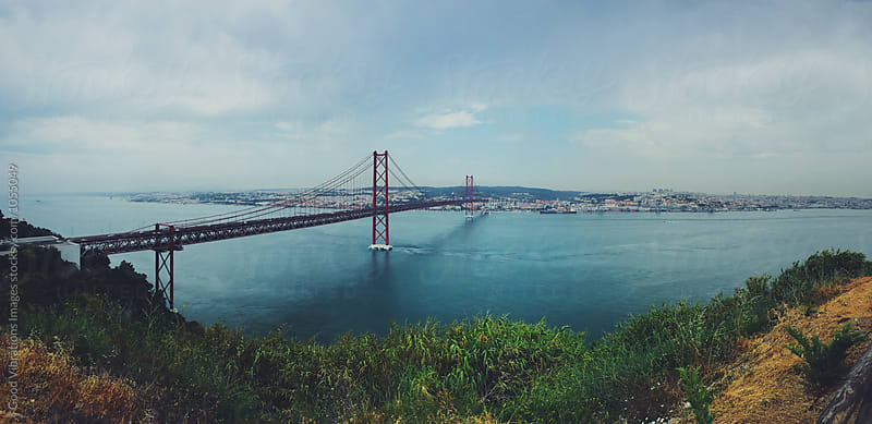 Panoramic view of Lisbon and 25 April Bridge by Good Vibrations Images for Stocksy United