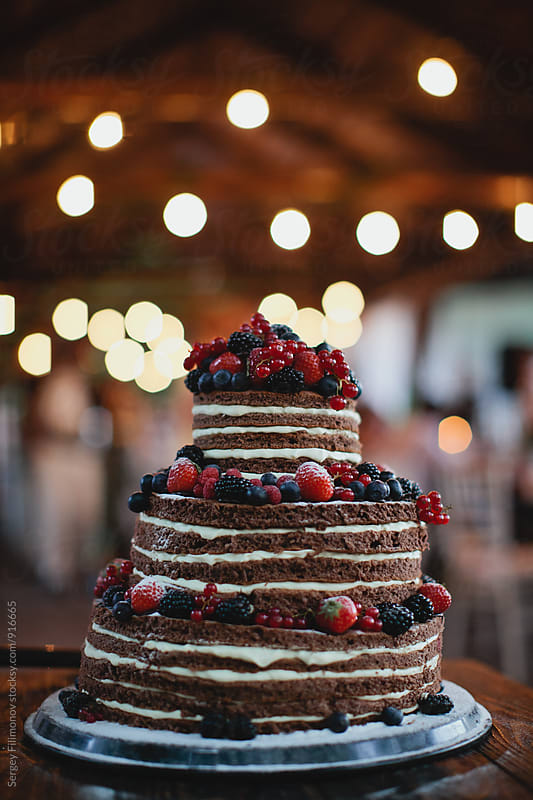 Chocolate cake with berries on the wedding by Sergey Filimonov for Stocksy United